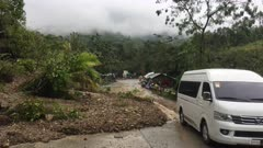 Landslide Covers Road After Heavy Rainfall