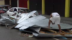 Man Salvages Housing Materials Destroyed By Hurricane