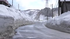 Massive Snow Banks Line Road In Winter