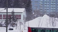 Snow Blows Off Rooftop In Strong Wind