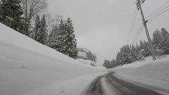 Driving Through Extremely Deep Snow Banks In Winter