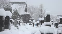 Heavy Snow Blankets Cemetery During Major Winter Storm