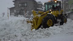 Heavy Machinery Plows Huge Amount Of Snow During Blizzard
