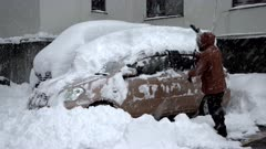 Man Clears Huge Amount Of Snow From Car In Winter Storm