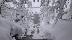 Temple And Trees Covered In Deep Layer Of Snow