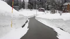Deep Snow Banks Line Road In Winter