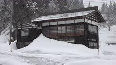 Huge Snow Drifts Bury Side Of House In Winter