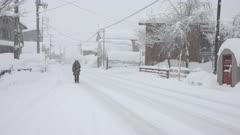 Woman Walks In Heavy Snow During Major Winter Storm