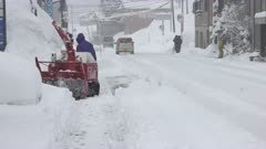 Snow Blower Works On Deep Snow Drifts In Blizzard