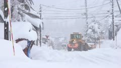 Snowplow Works Streets Buried In Snow During Blizzard