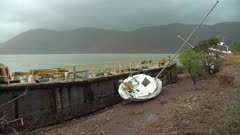 Barge And Yacht Washed Ashore In Aftermath Of Large Hurricane