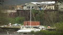 Heavy Damage To Boats And Buildings In Aftermath Of Major Hurricane