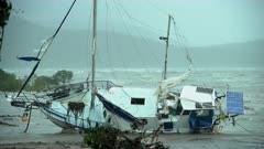 Yacht Washed Ashore By Hurricane Storm Surge And Strong Wind