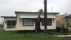 Palm Trees Lies On Top Of House After Severe Cyclone Makes Landfall
