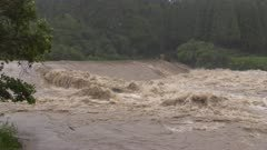 Churning River Flood Waters After Hurricane Dumps Heavy Rain