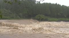 Churning River Flood Waters After Hurricane Dumps Heavy Rain