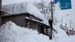 Man Digs Huge Snow Fall Off Roof After Blizzard