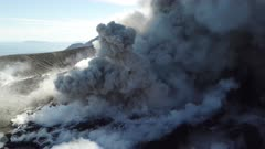 Explosions And Volcanic Ash Eruptions Inside Crater Of Volcano