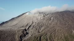 Aerial Footage Close To Steaming Volcanic Crater