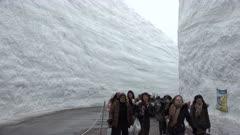Tourists Visit Immense Snow Canyon In Tateyama Japan