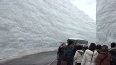 Bus And Tourists At Deep Snow Canyon In Tateyama Japan