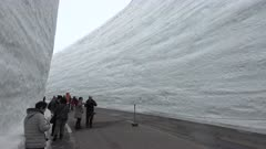 Massive Snow Drifts Line Road At Famous Snow Canyon In Tateyama Japan