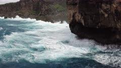 Aerial Footage Large Waves Crash Into Rugged Coastline