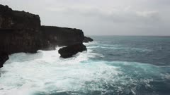 Aerial Footage Rough Sea Waves Along Rugged Coastline