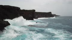 Aerial Footage Large Waves Crashing Into Rugged Cliffs