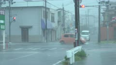 Traffic On Streets Of City In Powerful Wind And Rain Of Approaching Hurricane