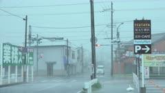 Debris Flies Past Camera As Hurricane Force Winds Hit Town