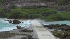 Storm Tide Floods Coastal Walkway