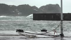 Large Storm Waves Sweep Past Sheltered Harbor And Sea Wall