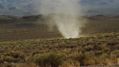 Dust Devil, Whirlwind, Desert Tornado churns amongst the sage brush in the Mojave Desert