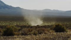 Dust Devil, Whirlwind, Desert Tornado churns through the scrub and sage brush in the Mojave Desert