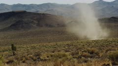 Dust Devil, Whirlwind, Desert Tornado nearly stationary as it churns harmlessly in the Mojave Desert