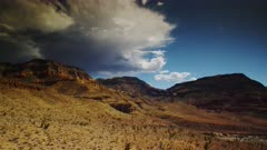 Developing Monsoon Storm crawls across the Painted Buttes and Mountains of North Western Arizona