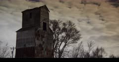 Abandoned Grain Mill with late winter gloom and barren trees