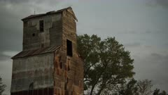 Abandoned Grain Mill with springtime budding trees