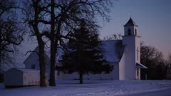 Rural Midwest Church on Snowy Evening at Twilight during the Christmas Holidays