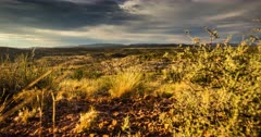 Desert storms clear with the brilliance of magic hour and dusk blankets the high desert in fading light