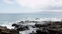 Maui Island Hawaii - Waves Crashing on Rocky Coast with Lanai Island