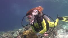 female scuba diver with oval mask