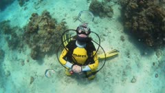 scuba girl blowing air bubble rings