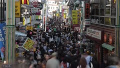 Tokyo Downtown Street Between Tall Buildings, Crowded With Pedestrians