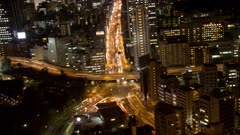 Traffic In Tokyo, City Lit Up At Night