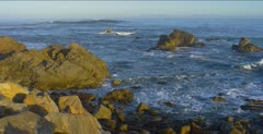 Ocean scenic, waves break over nearshore rocks