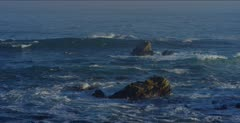 Ocean scenic, waves break over nearshore rocks, 48fps