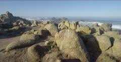 Ocean scenic, waves break over nearshore rocks, jib arm shot