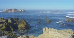Ocean scenic, waves break in Monterey Bay, pan left
